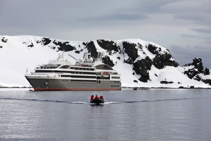 Antarctica; Le Boreal Cruise Ship and guests in a Zodiac boat 2