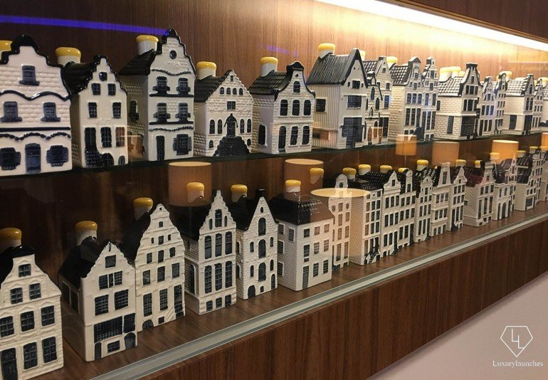 I want to collect them all - KLM's Delft Blue House on display at the KLM lounge in Schiphol.