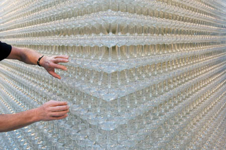 "A worker adjusts glasses in an attempt to break the world record for the ""Largest Champagne Fountain"" in Wijnegem"
