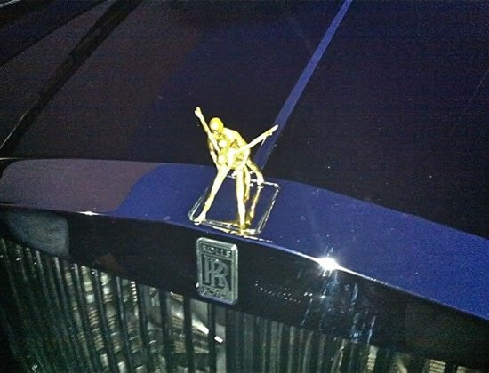 rolls royce s mascot spirit of ecstasy gets a cheeky makeover. Black Bedroom Furniture Sets. Home Design Ideas