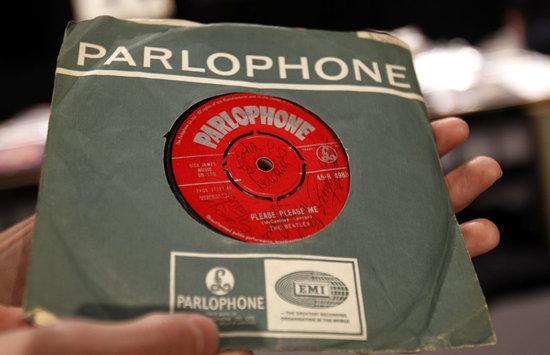 Signed-Beatles-single-Please-Please-Me-thumb-550x355