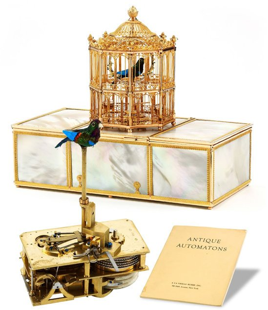 gold_and_Pearl_musical_bird_Cage-thumb-550x635