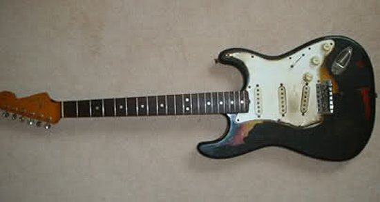 jimi hendrix 39 s scorched guitar sells for about 400 000. Black Bedroom Furniture Sets. Home Design Ideas