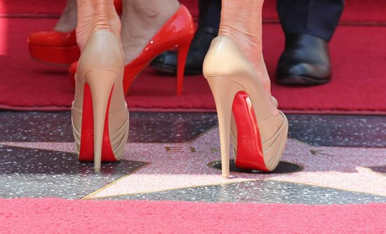 Red Soles Are Exclusive To Christian Louboutin Ysl Walks Away With