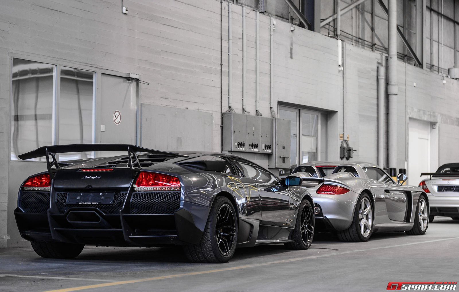 Garage Sports Car : A peak inside garage packed with sports luxury and