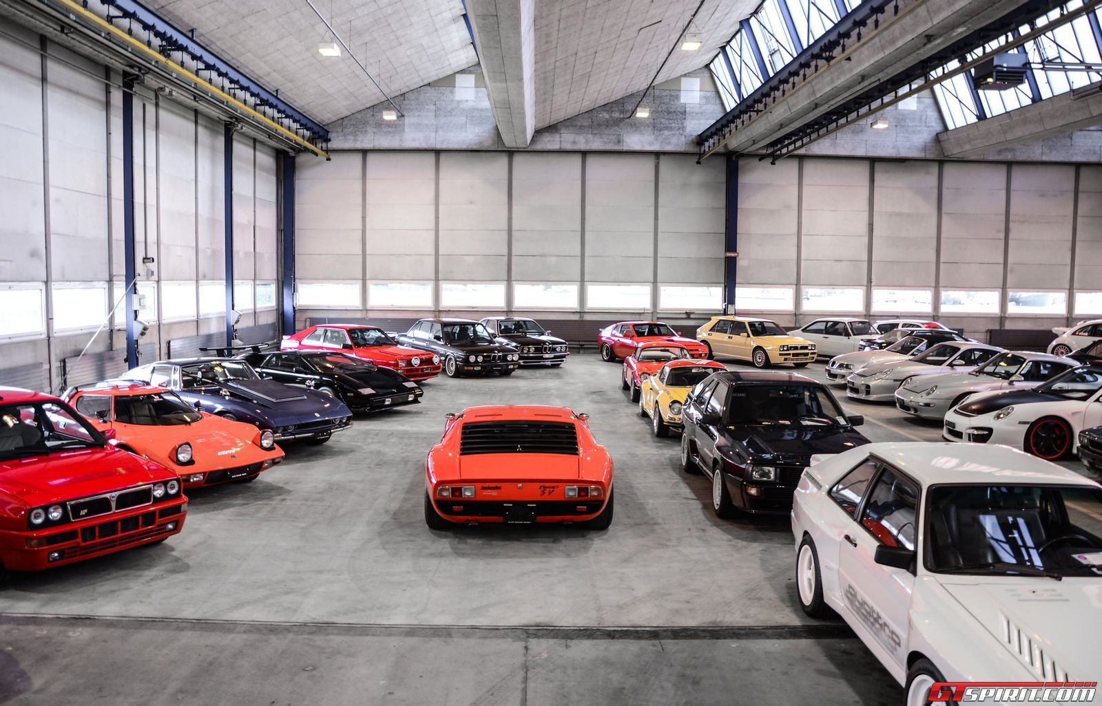 A peak inside a garage packed with 1100 sports luxury and for Car and garage