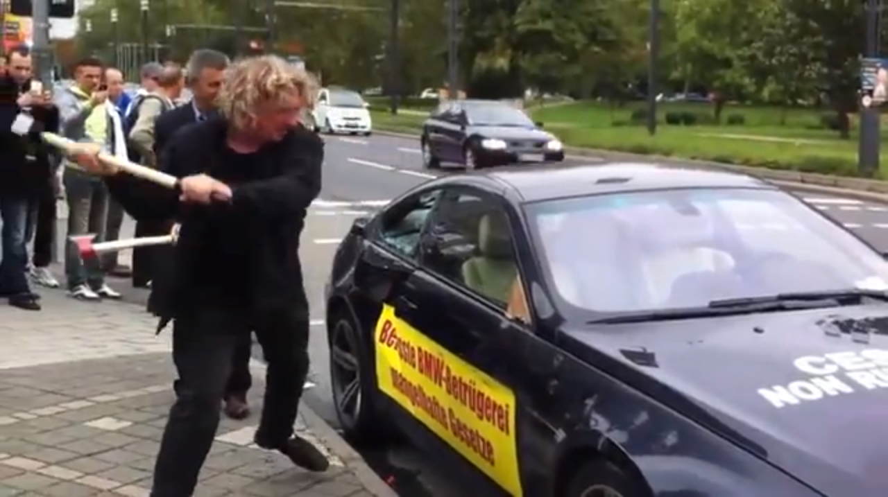 Man frustrated with poor customer service sledgehammers his $160,000 BMW M6 at the entrance of Frankfurt auto show -