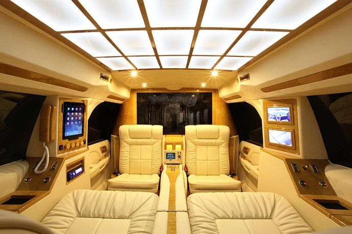 customized cadillac escalade comes with a bar home. Black Bedroom Furniture Sets. Home Design Ideas