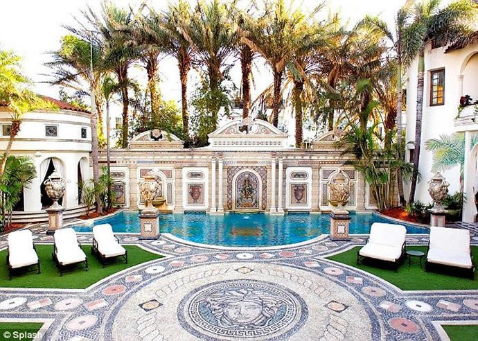 swim in a 24 carat gold pool at the versace villa in miami