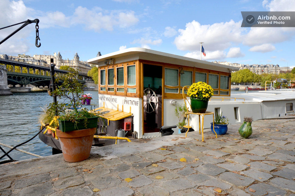 this houseboat under the eiffel tower on airbnb might just