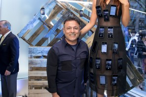 Designer Elie Tahari creates a dress strapped with 50 iPhones for the NY Fashion week