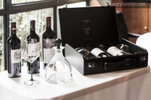Limited edition Lalique wine glasses by James Suckling served in style in a Ferragamo briefcase