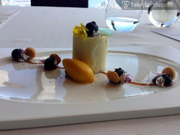 White chocolate yogurt mousse with cassis crème almonds, raspberry jam and mango sorbet