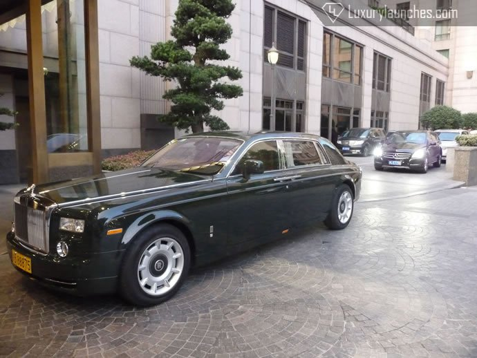Our pick up - Rolls Royce Extended wheelbase Phantom in Peninsula green.