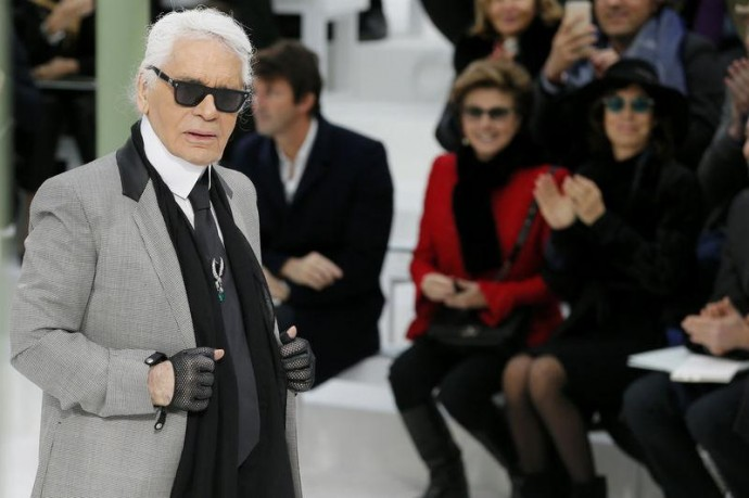 German designer Karl Lagerfeld appears at the end of his Haute Couture Spring Summer 2015 fashion show for French fashion house Chanel in Paris