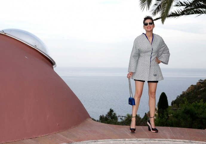 Looking on to cliffs and palm trees, and surrounded by the azure waters of the South of France, the house now belongs to another legendary designer Pierre Cardin, who was also in attendance, along with Marion Cotillard (pictured above).