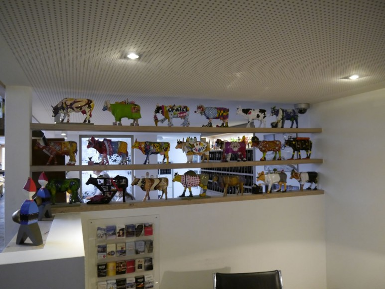 A variety of cows line up the lobby.