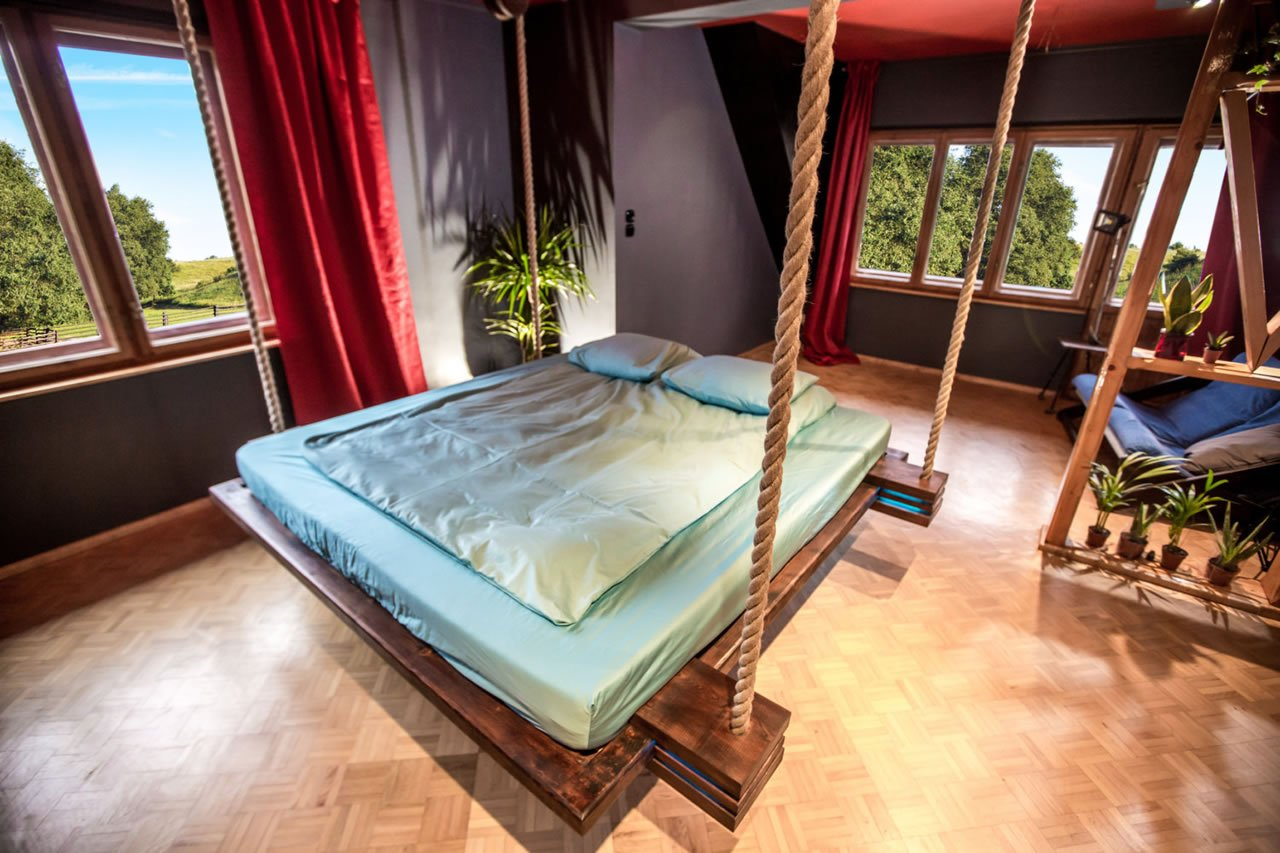 designer wiktor ja wiec s hanging bed hovers 18 inches off the ground. Black Bedroom Furniture Sets. Home Design Ideas