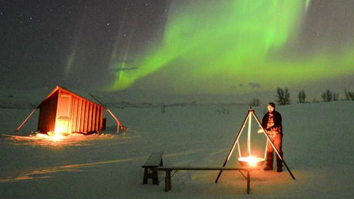 Stay in icy huts against the backdrop of the dazzling Northern Lights