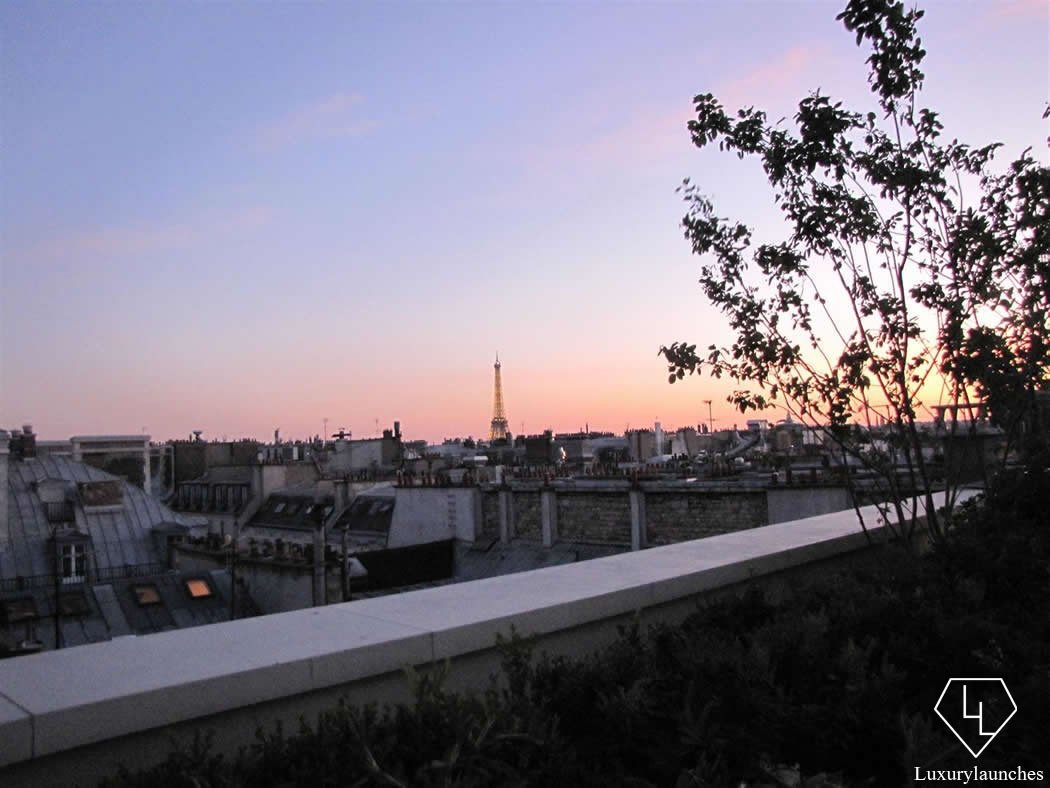 We step on to the wraparound balcony to watch the Eiffel Tower at sunset.