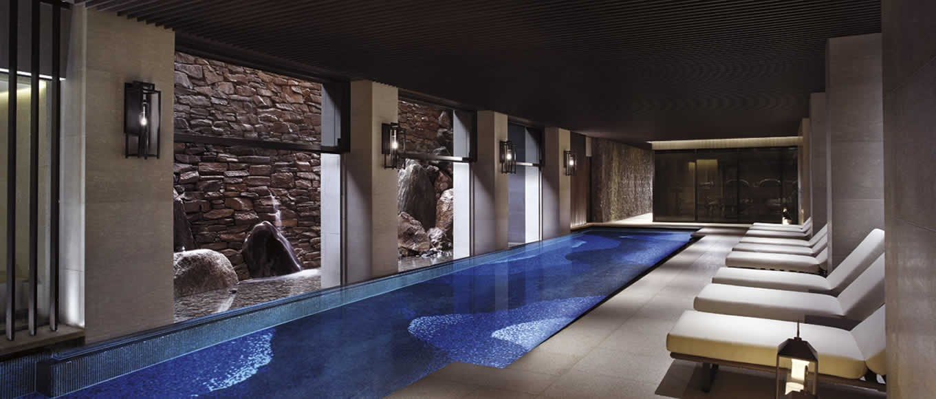 The indoor swimming pool with a Zen rock wall