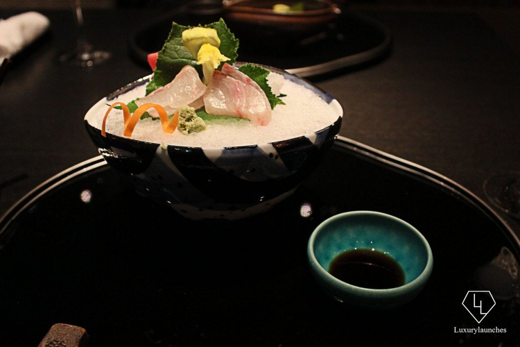 Food meets art with this white fish sashimi on ice