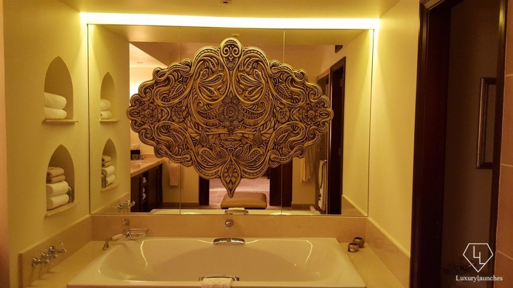 Ornate mirror in a bathroom in The Palace