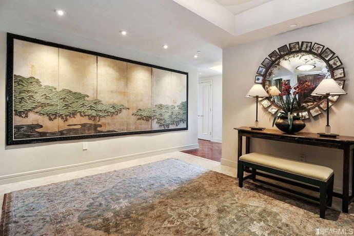 The-marble-entryway-welcomes-guests-into-the-three-bedroom-apartment-