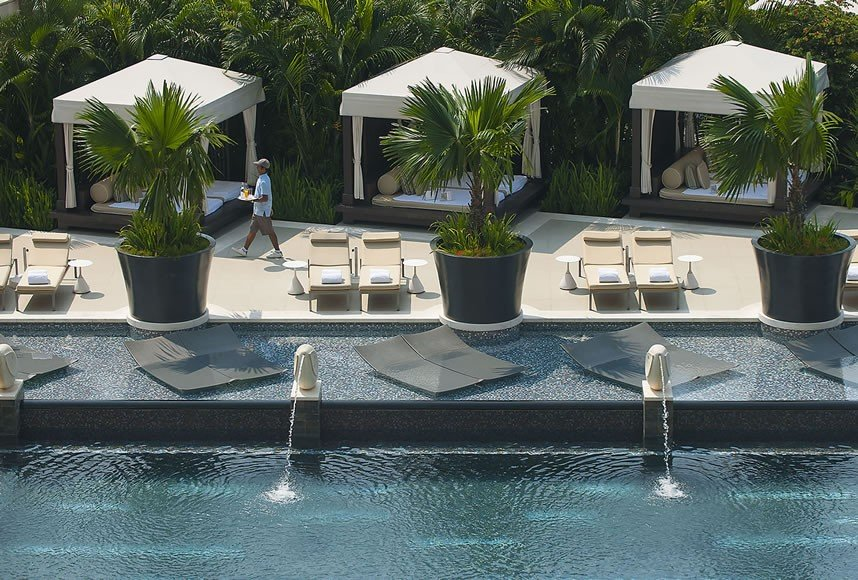 The 25-metre swimming pool is surrounded by lush gardens and spectacular views of the Singapore skyline