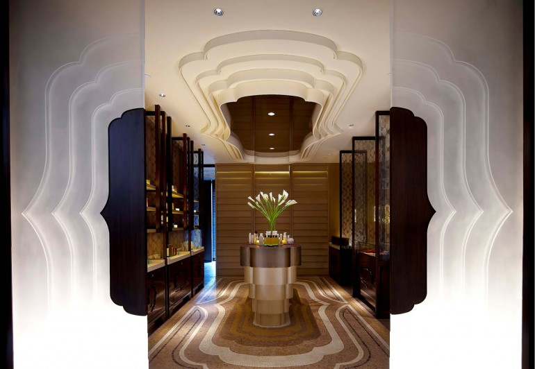 The entrance of the spa features a cloud silhouette motif that is seen throughout the spa in its décor and light fixtures