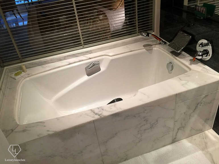 My very own marble bathtub — bath salts included