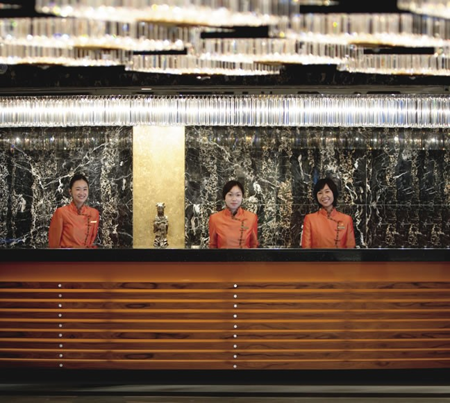The reception area and orange qipao-wearing staff are just two iconic things in the hotel that haven't changed in years