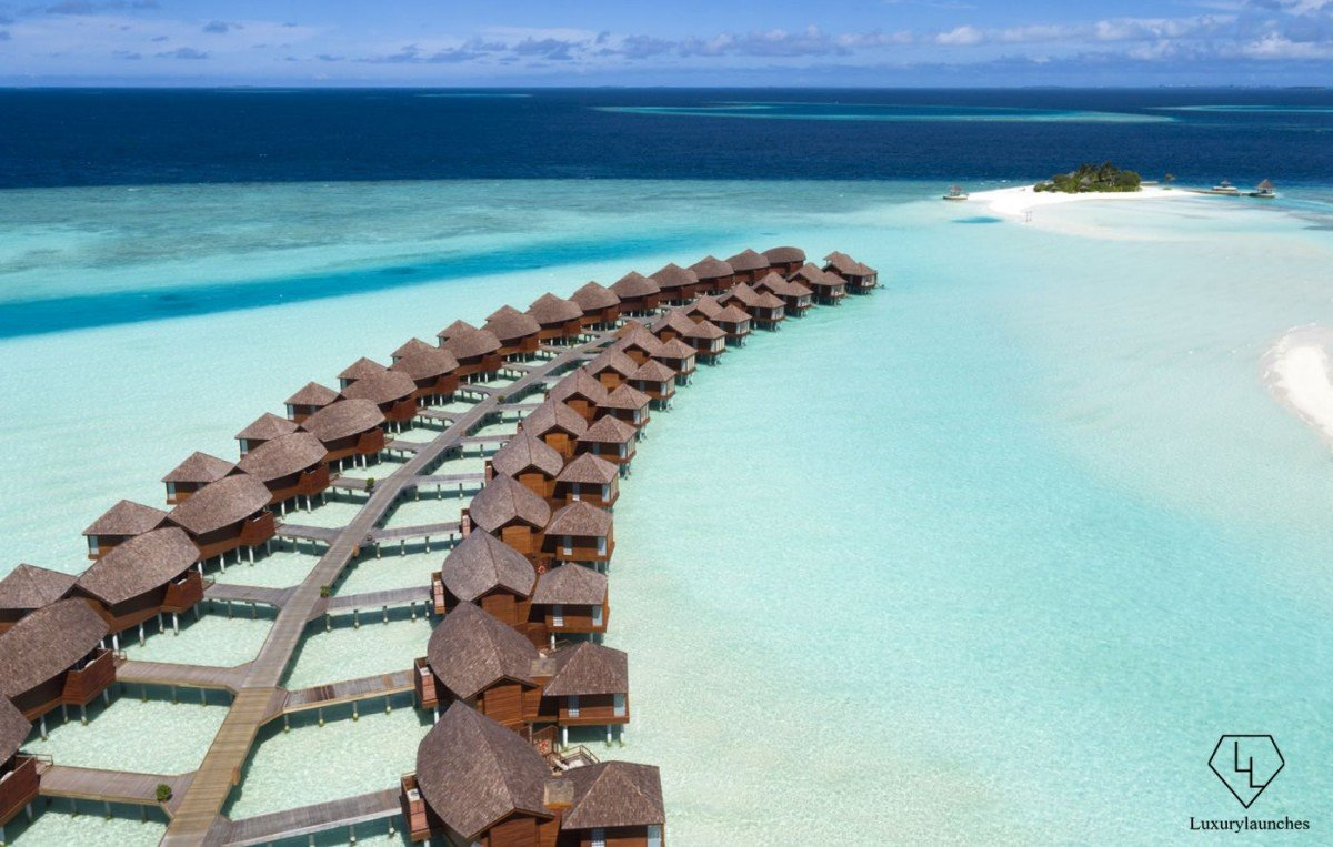 Anantara_Dhigu_Resort_Aerial_Over_Water_Suites_and_Gulhifushi_snorkelling_island