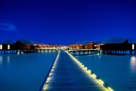 Anantara_Dhigu_Resort_approach_to_Over_Water_Suites_nighttime