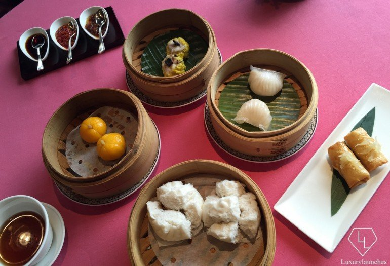 The first round (clockwise from extreme right) scallop and pomelo puff, barbecued Iberian pork bun, crabmeat and pumpkin dumpling, siu mai with black truffle, and tiger prawn and bamboo shoot dumpling