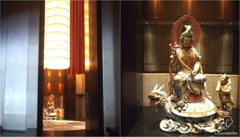 Elevator waiting area with Guan Yin and crystal chandelier