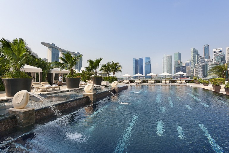 The outdoor swimming pool offers an oasis from the humid heat