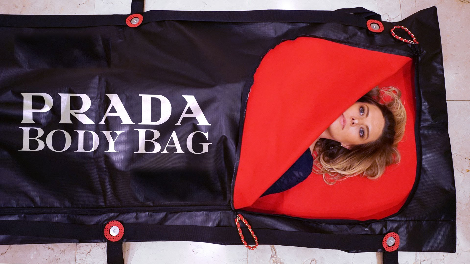 0d7b8f15df Saying farewell to the world in a Prada body bag -
