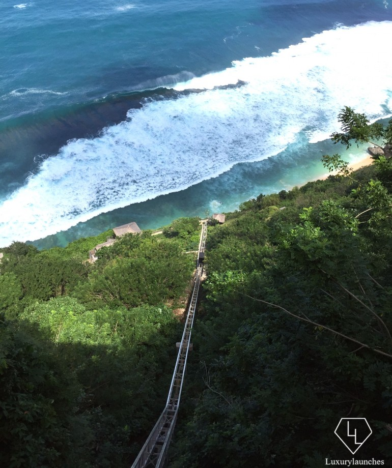 Riding down almost 150 metres on the hotel's funicular to the La Spaggia beach club