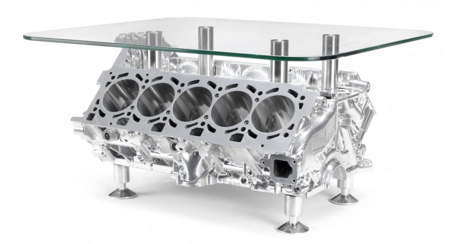 A coffee table made from a shot-blasted 5.2-liter Lamborghini V10 engine -