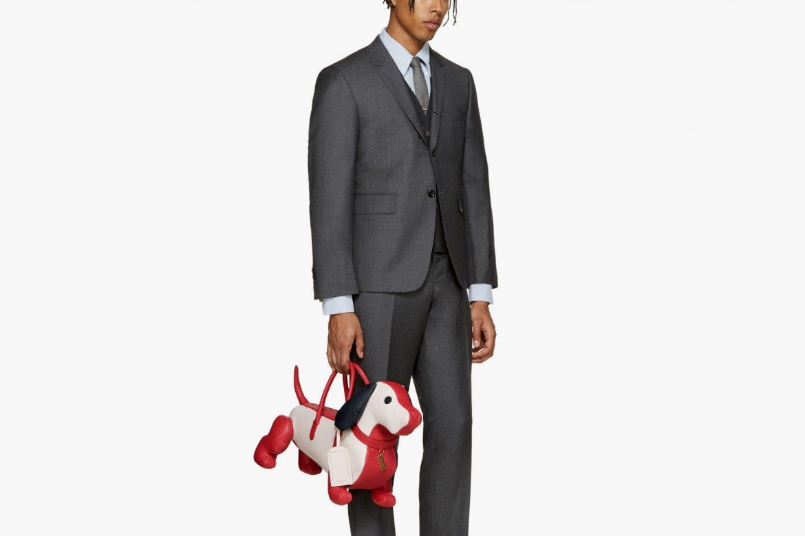 """c3cb0fcb56b It is hard to keep a straight face even writing about this. Can you take a  man who carries a dachshund-shaped business """"bag"""" seriously? No, right!"""
