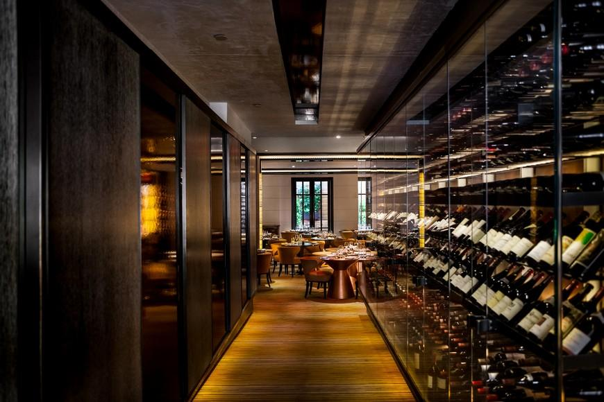 Hallway with wine wall leading into the main bar seating area at Jean Georges'  restaurant.