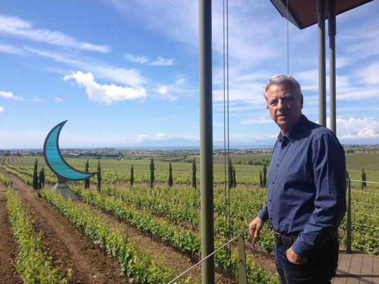 Vangelis Gerovassiliou in front of his vineyard overlooking the Olympus mountain