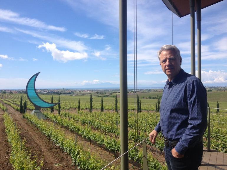 Vangelis Gerovassiliou in front of his vineyard overlooking the Olympus mountain
