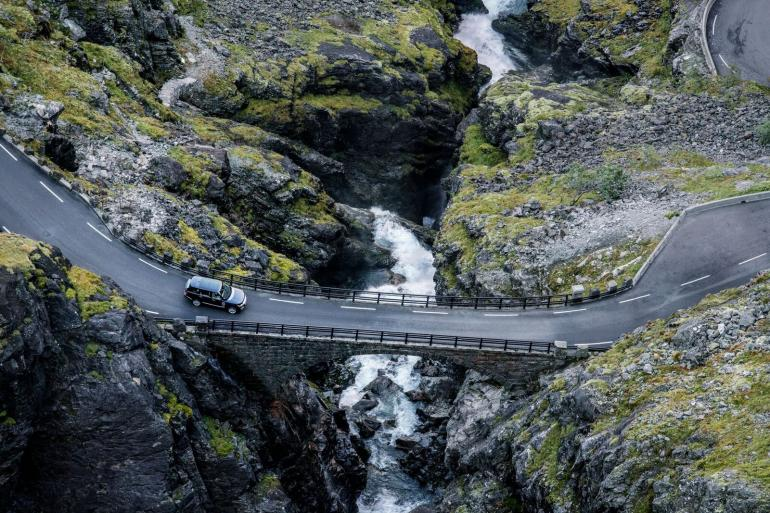Here we can see our Range Rover crossing a bridge midway up the famous Trollstigen (Troll's ladder) road. The bridge lies right underneath the 180-meter high Stigfossen waterfall. This section of the road includes 11 hairpin turns, which make for a breathtaking driving experience as well as having a dramatic visual impact