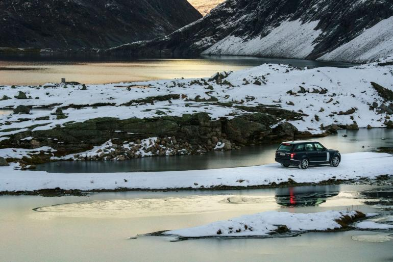 """""""This shot captures us driving in the early October snow on the mountain plateau beneath Dalsnibba peak in Møre og Romsdal county. The character of locations really changes with the time of day and the lighting and in this shot, as dusk hit, the last rays of the evening sun produced an amazing array of colors in the Djupvatnet lake."""""""
