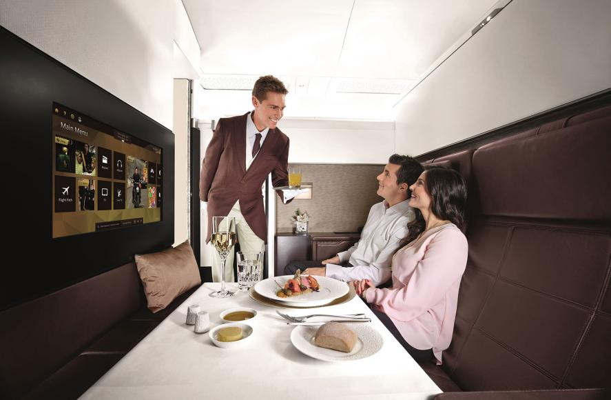 etihad-airways-butler-serving-food-to-couple-on-plane