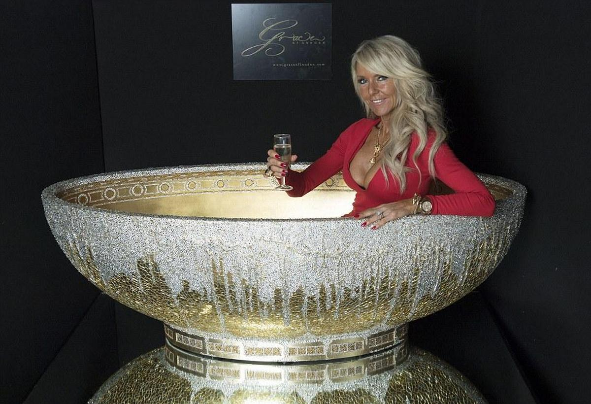 Dipped in gold and studded with 250,000 crystals, this is one blinged bathtub : Luxurylaunches