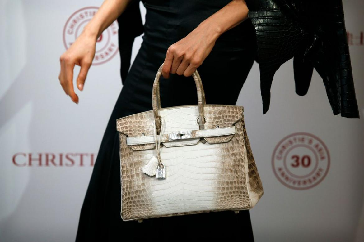 7882a5f80f67 The auction took place not too long ago and the bag in question was a  Himalaya Niloticus crocodile diamond Birkin 30.