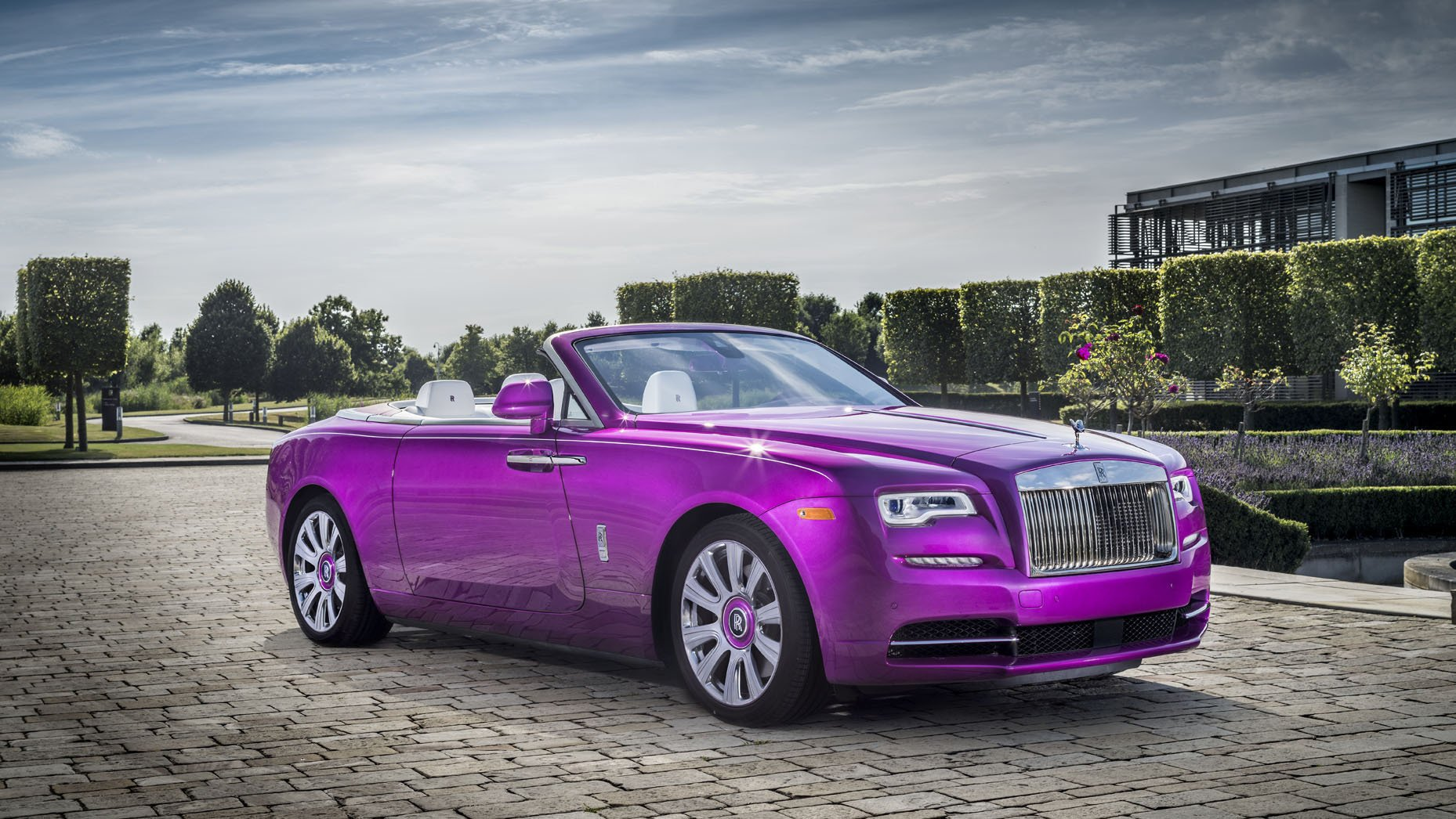 A Rolls Royce Dawn in pink that is perfect for a princess
